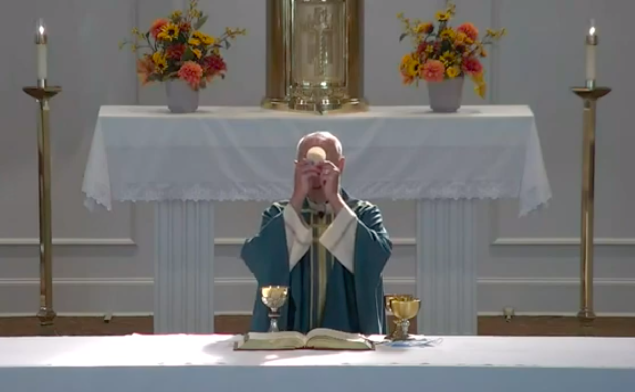 How may I receive the Holy Eucharist after watching Mass online or on TV?